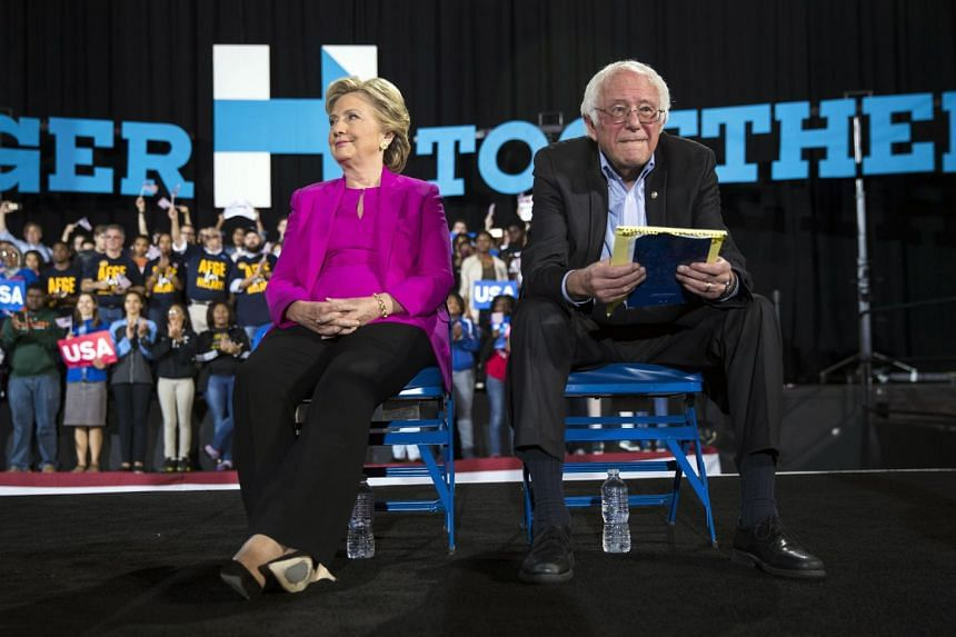 A 2016 photo shows Clinton (left) and Sanders during a rally in North Carolina.