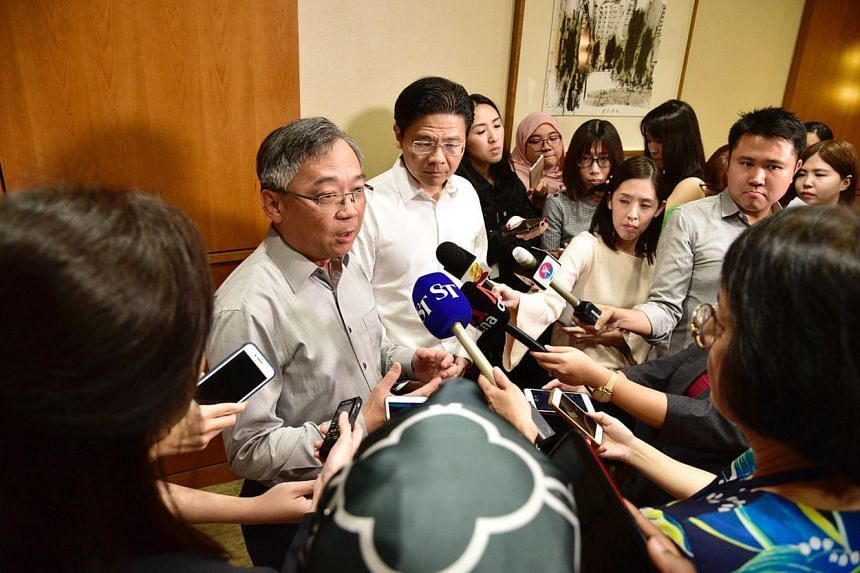 Health Minister Gan Kim Yong, alongside Minister for National Development and Second Minister for Finance Lawrence Wong, announces the launch of the multi-ministry task force to tackle the Wuhan virus on Jan 22, 2020.
