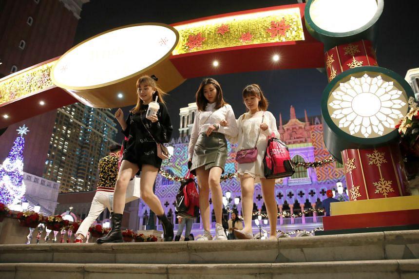 People leaving the Venetian Macao casino in Macau, on Dec 20, 2019.