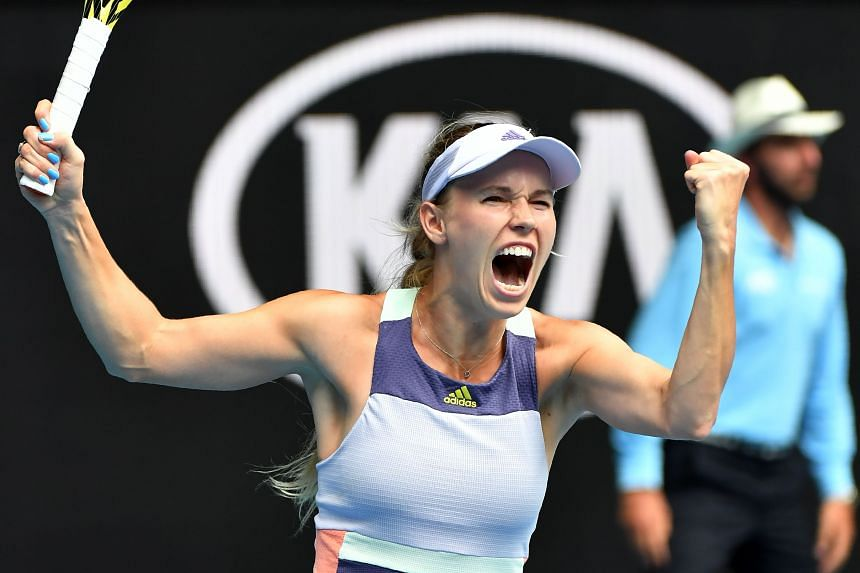 Emotional Wozniacki keeps final tournament alive at Australian Open