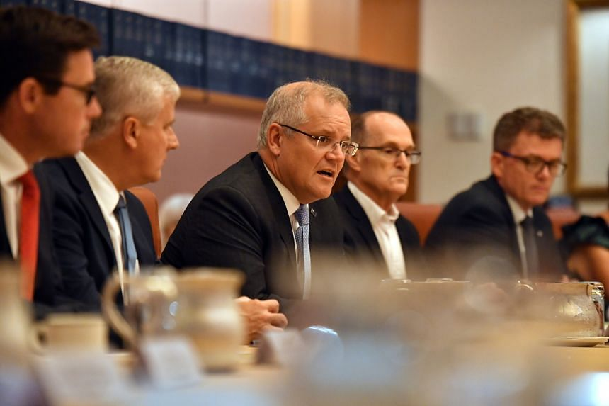 Australia's PM Scott Morrison (centre) speaking at the Bushfire Relief and Recovery Efforts Peak Body Roundtable, on Jan 17, 2020.
