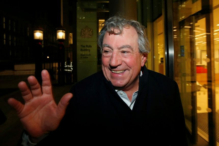In a picture taken on Nov 30, 2012, British comedian Terry Jones smiles as he leaves The Rolls Building in central London.