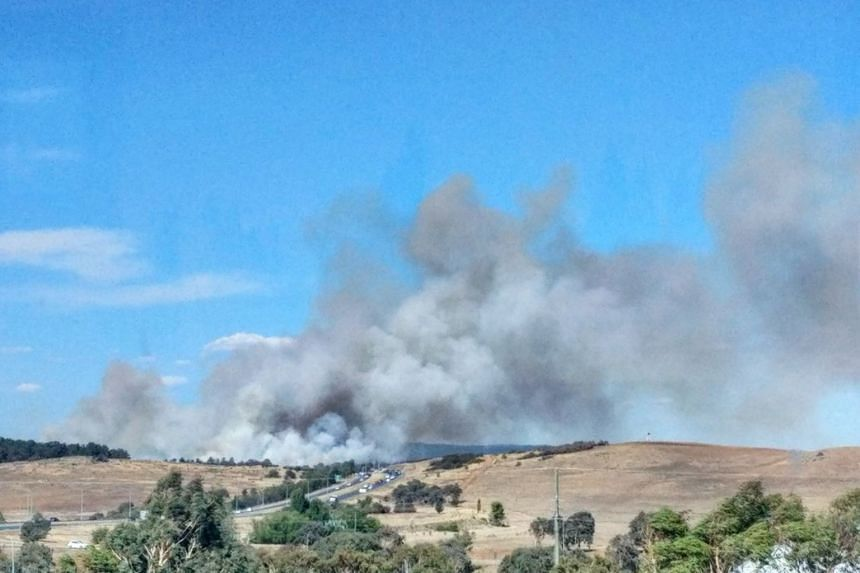 Photos posted on social media showed grey smoke billowing above the city's suburbs.