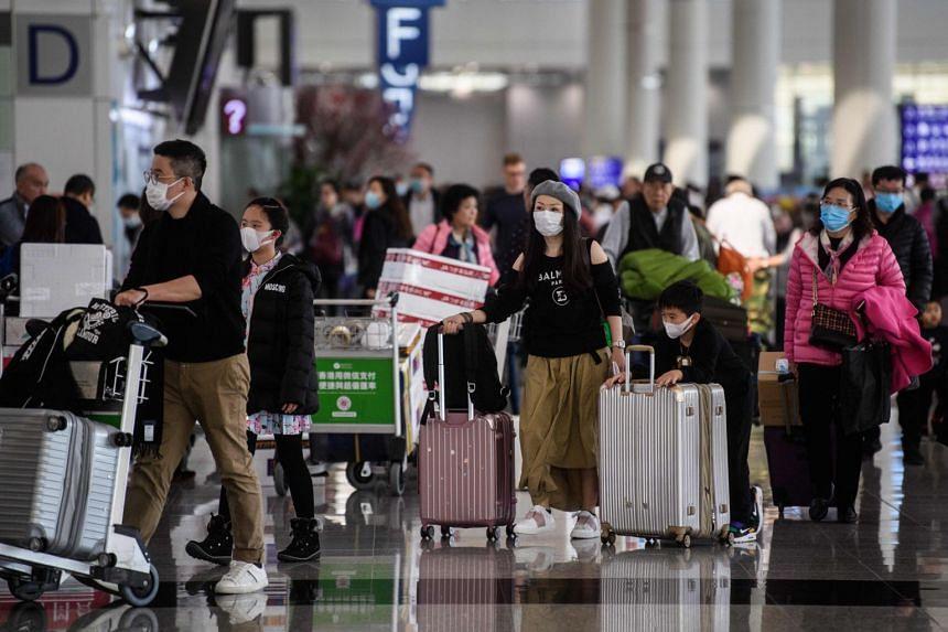 Passengers wearing face masks at Hong Kong's international airport, on Jan 22, 2020.