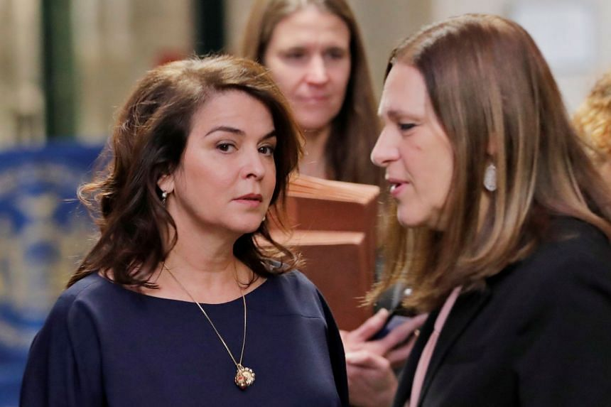 Annabella Sciorra (left) arrives to testify as a witness.