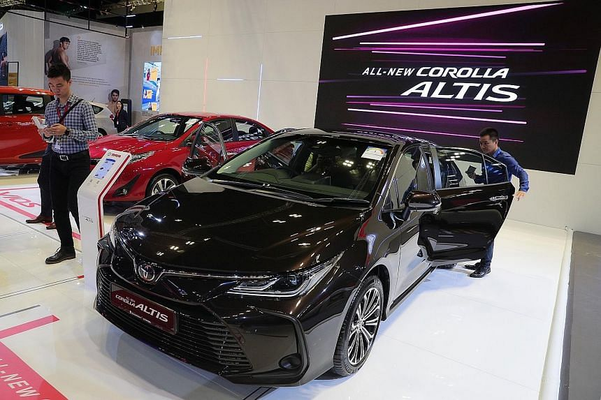 A Toyota Corolla Altis on display at the Singapore Motorshow at the Suntec Singapore Convention and Exhibition Centre on Jan 9. The Japanese marque led the list of top 10 best-selling car brands last year.