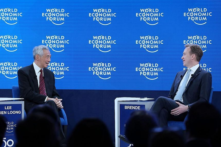 Prime Minister Lee Hsien Loong in a dialogue with World Economic Forum president and former Norwegian foreign minister Borge Brende in Davos yesterday. PHOTO: MCI