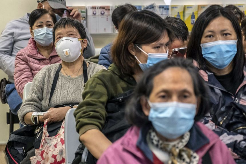 People wearing face masks in a waiting area at the Prince of Wales Hospital in Hong Kong, on Jan 22, 2020.