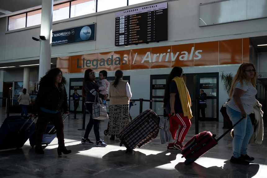 Passengers walk near the arrivals gate at the Abelardo L. Rodriguez International airport in Tijuana, Mexico, on Jan 22, 2019.