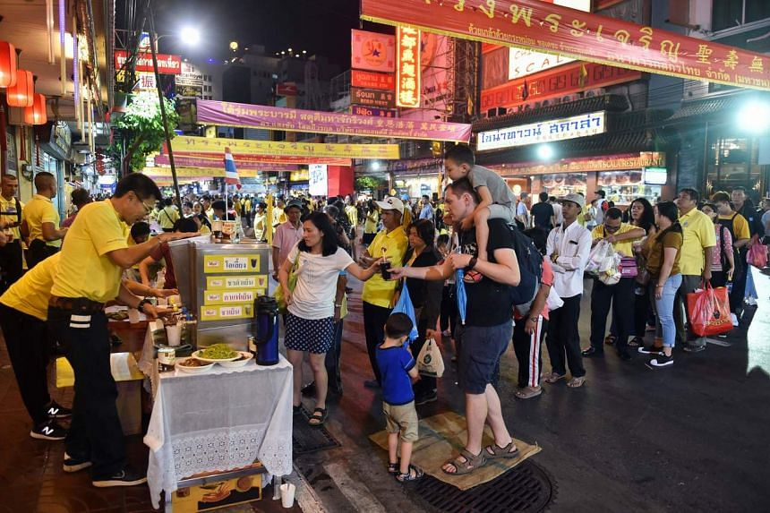 Local residents and tourists line up at a stall in the Chinatown district of Bangkok, on Dec 6, 2019.