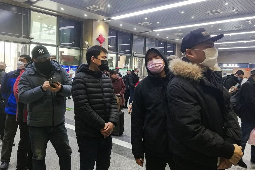 Commuters wearing face masks at Wuchang railway station in Wuhan, in China's central Hubei province, on Jan 22, 2020.