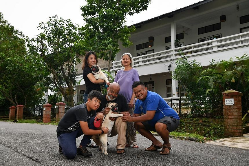 Jalan Hang Jebat residents Jean-Luc Amerasinghe (left, front row), with his father Brian Amerasinghe, neighbour David Santhanansamy, Mr Santhanansamy's wife Esther Jane De Rozario, and Mr Amerasinghe's wife Iris Tan Lay Lan, outside their houses with