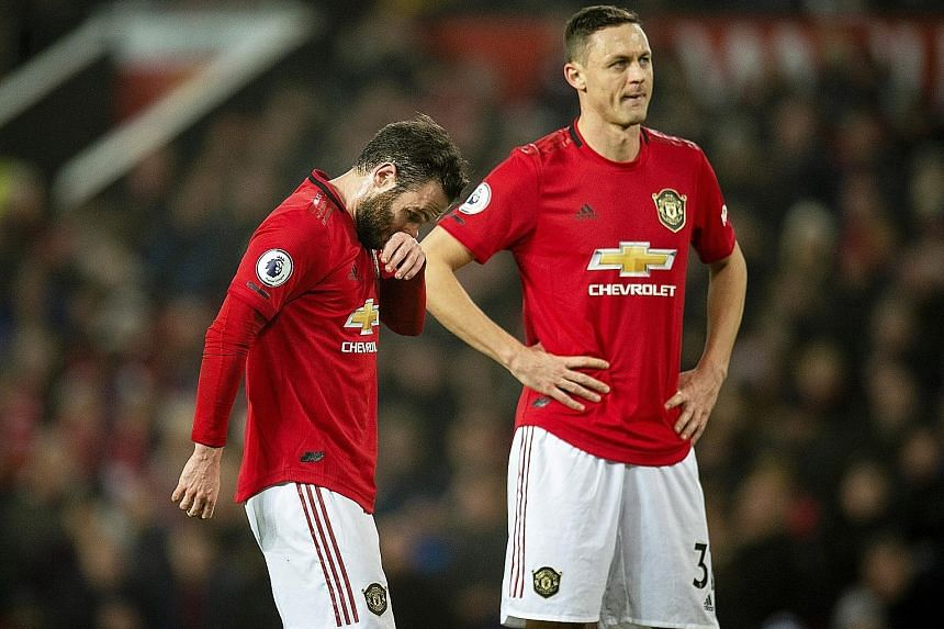 Manchester United midfielders Juan Mata (left) and Nemanja Matic are part of an underwhelming Red Devils squad experiencing their worst top-flight season in 30 years. PHOTO: EPA-EFE