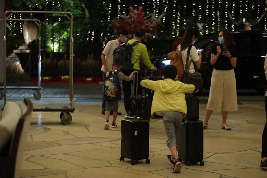 Guests leaving the Shangri-La's Rasa Sentosa Resort & Spa on Jan 23, 2020.