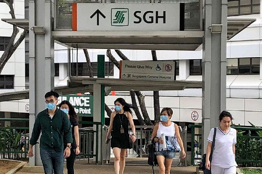People wearing masks at SGH. The 66-year-old man from Wuhan, who is Singapore's first confirmed case, is currently in stable condition at the hospital.