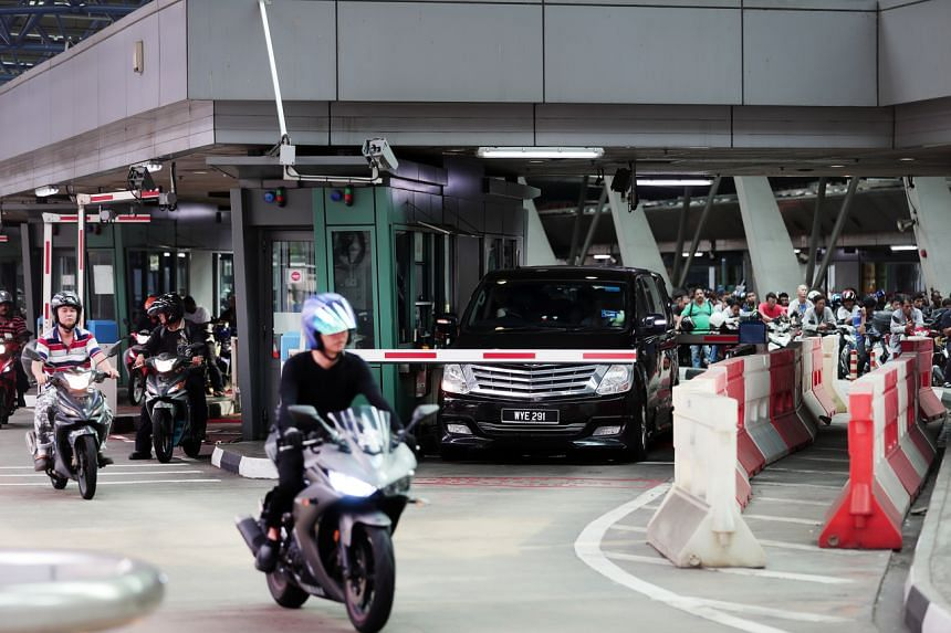 Before reaching the immigration counters, travellers in cars will have to wind down their windows to have their temperature taken, and those on motorcycles will have to remove their helmets.