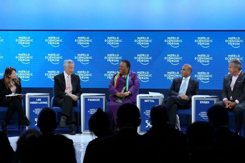 (From left) Moderator Roula Khalaf, of the Financial Times; PM Lee; Grace Naledi Mandisa Pandor, Minister of International Relations and Cooperation, South Africa; Sunil Bharti Mittal, chairman, International Business Council, Bharti Enterprises; and