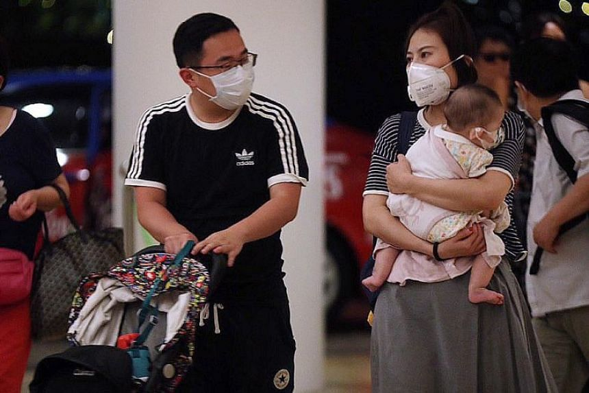 Guests at Shangri-La's Rasa Sentosa Resort & Spa yesterday. A man from China who is the first to test positive for the Wuhan virus in Singapore had stayed at the resort, said the Health Ministry.