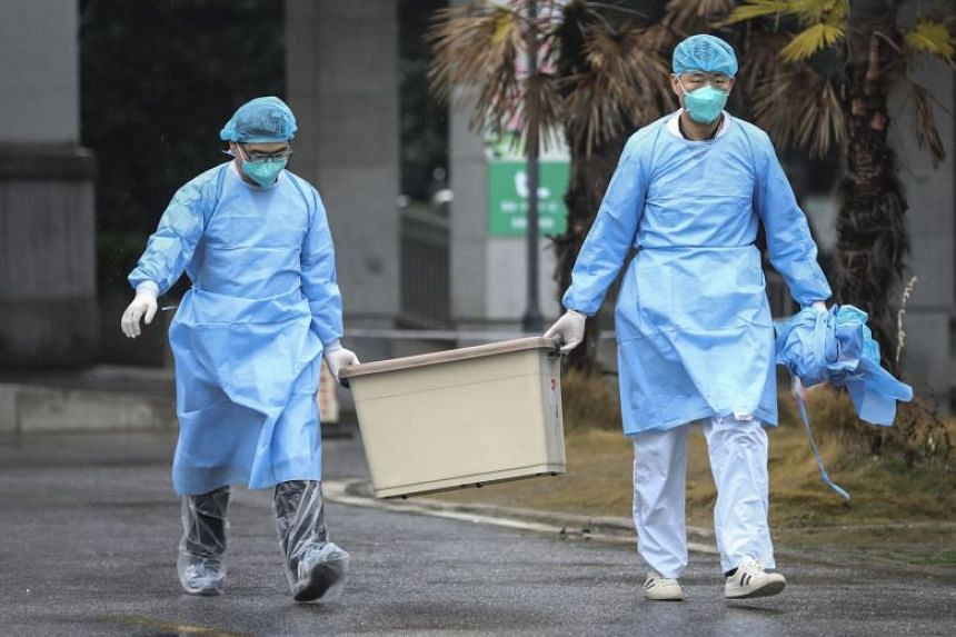 Hospital staff at the south building of the Wuhan Medical Treatment Centre on Jan 10, 2020.