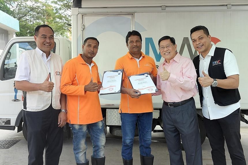 (From left) Mr Shamsul Kamar Mohamed Razali, executive director of the Centre for Domestic Employees; Mr Shamim Patwari and Mr Mostafa Kamal, cleaners from Bangladesh who found the baby; Mr Yeo Guat Kwang, chairman of the Migrant Workers' Centre (MWC