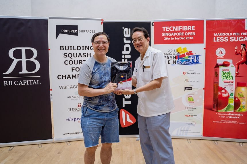 Singapore Squash Rackets Association president Patrick Thio (left) with his predecessor Woffles Wu at 2018's Singapore Squash Open.