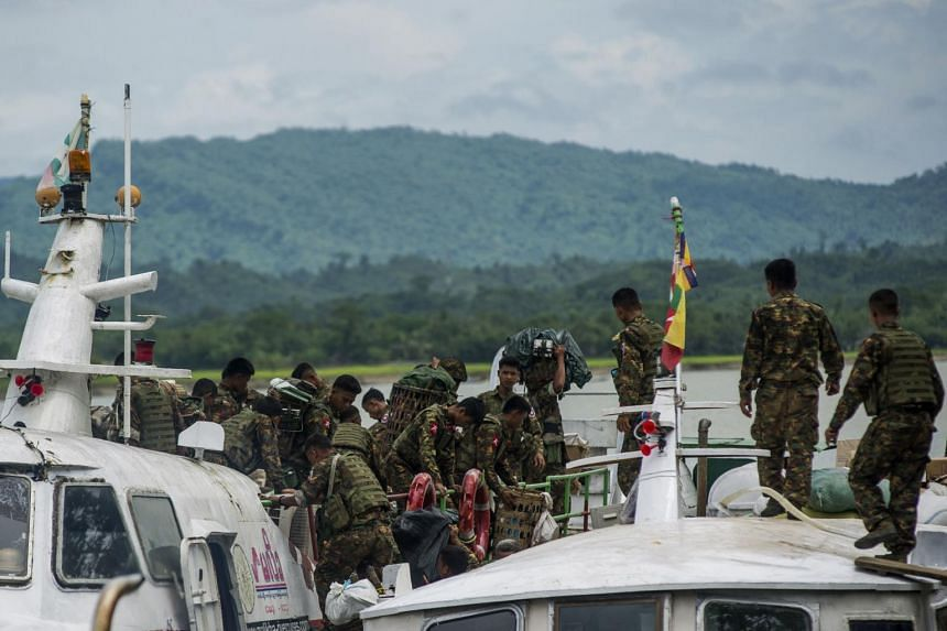 In this picture taken on Aug 29, 2017, soldiers arrive at Buthidaung jetty in Myanmar's Rakhine state.
