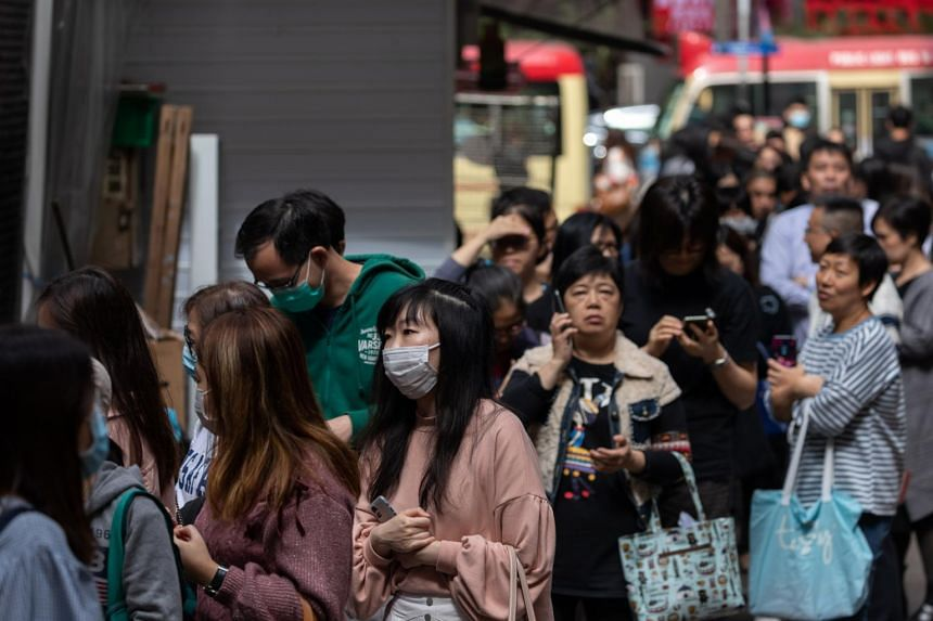 People line up for free vitamin C tablets and hand sanitiser in Hong Kong on Jan 24, 2020.