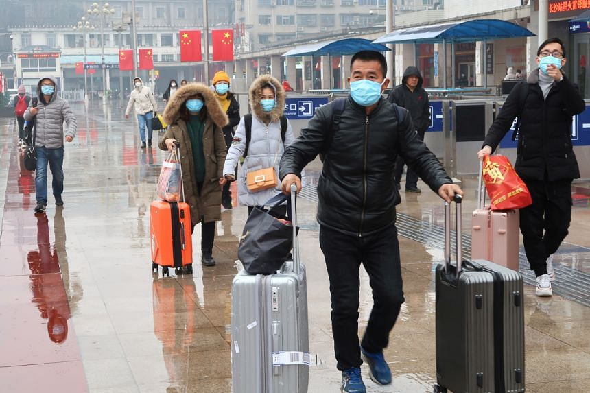 Passengers wearing masks are seen at the Changsha Railway Station, in Hunan province, China, on Jan 25, 2020.