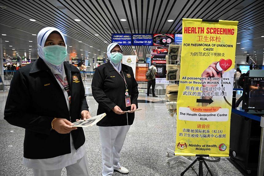 Malaysian health officers deployed at Kuala Lumpur International Airport in Sepang, on Jan 21, 2020.