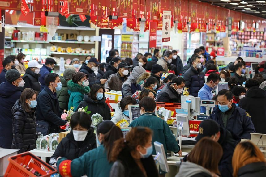 Shoppers at a supermarket in Wuhan in central China's Hubei province, on Jan 25, 2020.