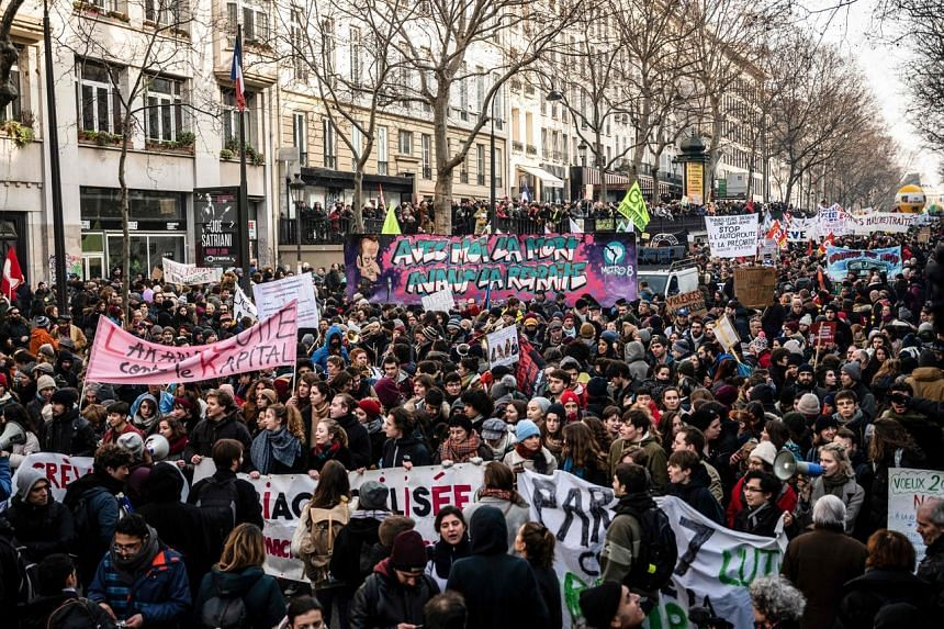 People take part in a demonstration against the French government's pensions overhaul in Paris on Jan 24, 2020