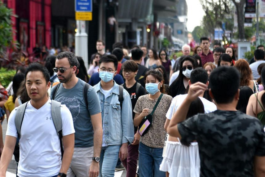 People are seen wearing masks as they walk down Orchard Road on Jan 26, 2020.