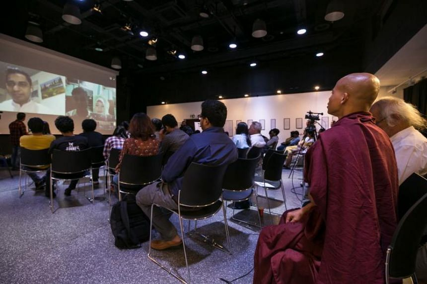 """People are seen at a """"Poetry for Humanity"""" event, in which Rohingya Muslim poets recited poetry via video link, in Yangon on Jan 25, 2020."""