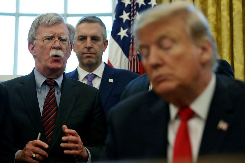 US President Donald Trump's former adviser John Bolton's (left) explosive account was included in drafts of a manuscript he has circulated in recent weeks to close associates.