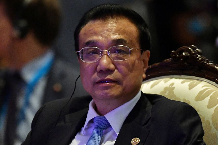 """Chinese Premier Li Keqiang was in Wuhan to """"investigate and guide"""" ongoing efforts to control the virus."""