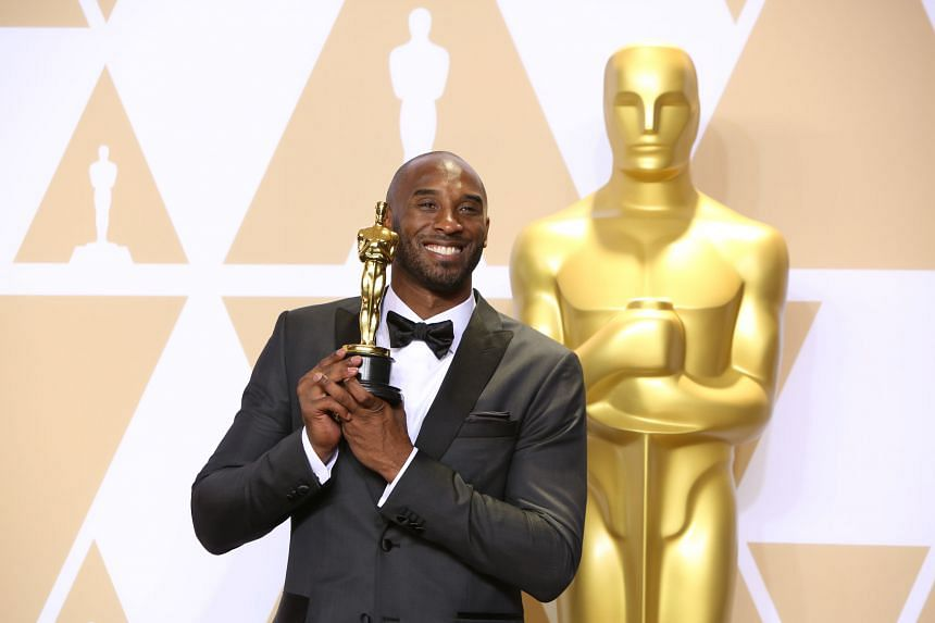 Kobe Bryant poses after winning best animated short film for Dear Basketball at the 90th Academy Awards at the Dolby Theater in Los Angeles, on March 4, 2018.