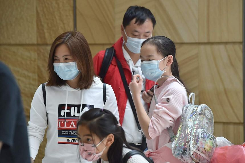 A family arrive at Sydney airport after landing on a plane from the Chinese city of Wuhan, on Jan 23, 2020.
