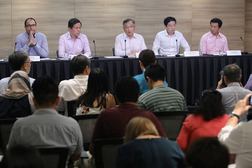 (From left) Communications and Information Minister S. Iswaran, Trade and Industry Minister Chan Chun Sing, Health Minister Gan Kim Yong, National Development Minister Lawrence Wong and Education Minister Ong Ye Kung at the press conference, on Jan 2