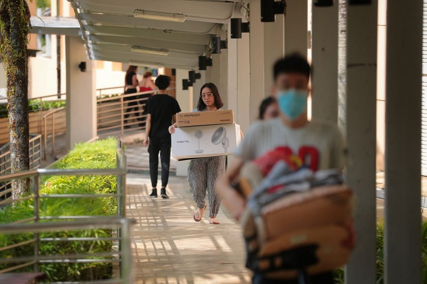 Students move their belongings to their new block at Prince George's Park Residences on Jan 27, 2020.