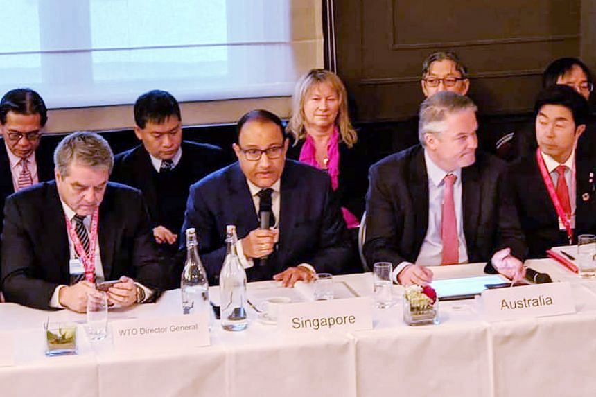 Communications and Information Minister S. Iswaran at a World Trade Organisation-related meeting in Davos, Switzerland, last week. Singapore, together with Australia and Japan, are co-convenors shepherding negotiations on digital trade rules at the W