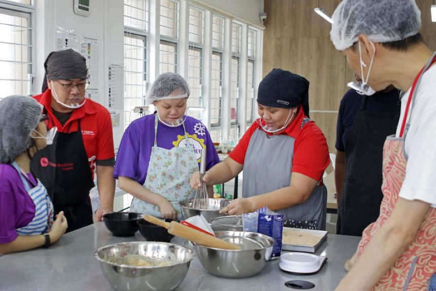 (From left) Trainee Chua Yi Ting, 29, assistant life skills coach Sua Heng Yeow, 50, trainee Lim Huey Ting, 27, and life skills coach Setoh Kelly, 33, during a baking session at Touch Centre for Independent Living's Bukit Merah branch last Thursday.
