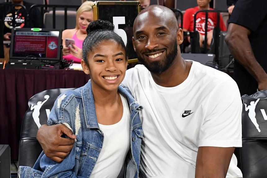 In a photo taken on July 27, 2019, Kobe Bryant is pictured with his daughter Gianna at the WNBA All Star Game at Mandalay Bay Events Center.