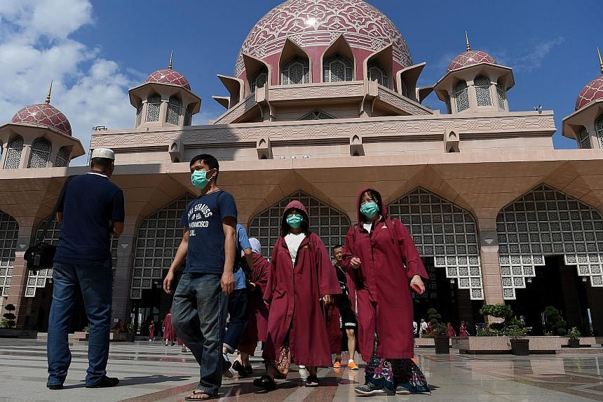 Visitors outside the Putra Mosque in Putrajaya on Sunday. The Malaysian government closed the mosque to visitors starting from Sunday, following the coronavirus outbreak. It has also halted entry to the country for Chinese travellers from Hubei provi