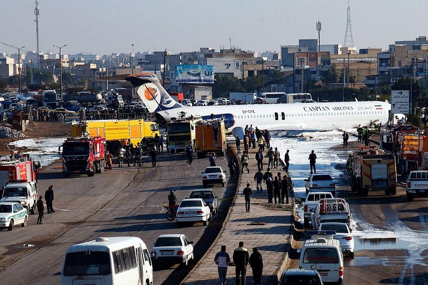 Iranian plane skids off runway into street; all 150 passengers safe