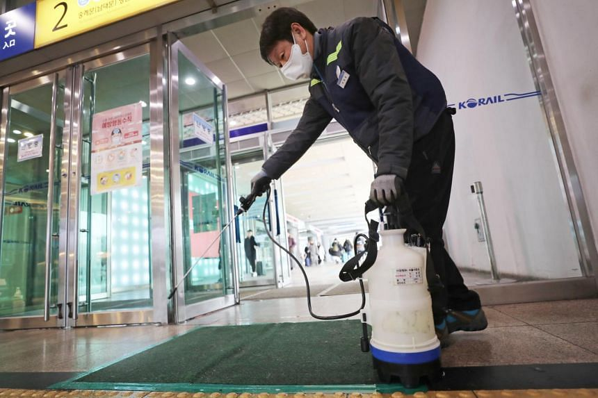 A man disinfecting one of the entrances of Seoul Station in South Korea, on Jan 27, 2020.