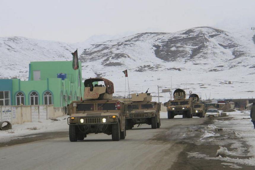 Afghan soldiers prepare to reach the scene of a plane crash near Ghazni, Afghanistan, on Jan 27, 2020.