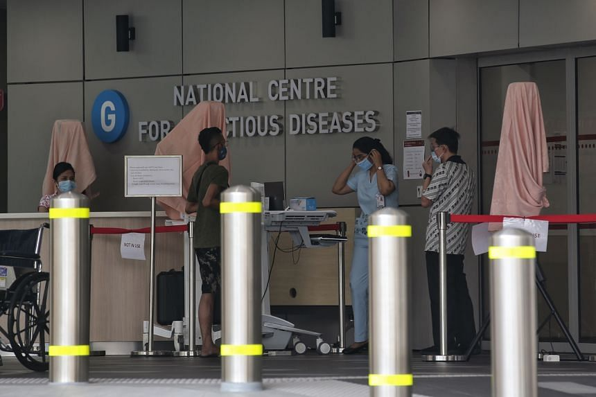People wearing masks around the premises of National Centre for Infectious Diseases on Jan 28, 2020.