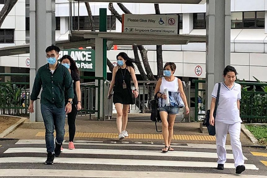 People wearing masks outside Block 5 at the Singapore General Hospital on Jan 24, 2020.