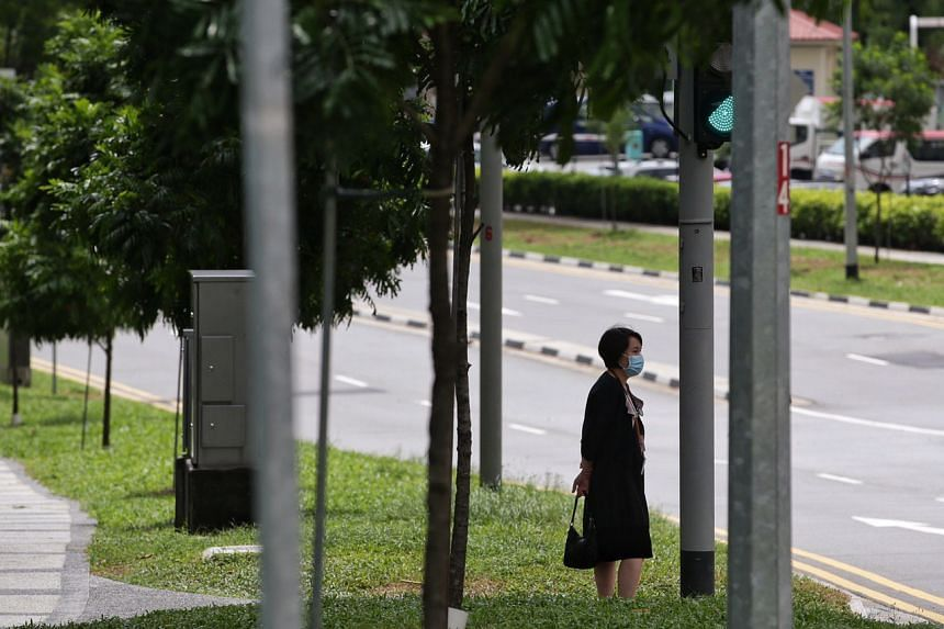A woman wearing a mask near the National Centre for Infectious Diseases on Jan 28, 2020. The Workers' Party has called for Singaporeans to stay united, remain calm and to heed instructions from the various ministries.