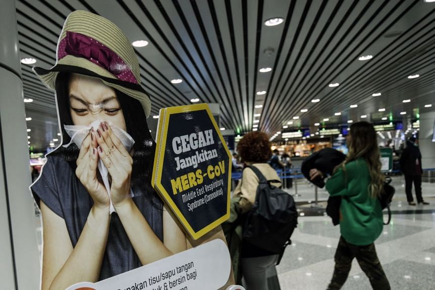 A poster informing passengers as they arrive at the Kuala Lumpur International Airport on Jan 21, 2020, that there is coronavirus-screening ahead.